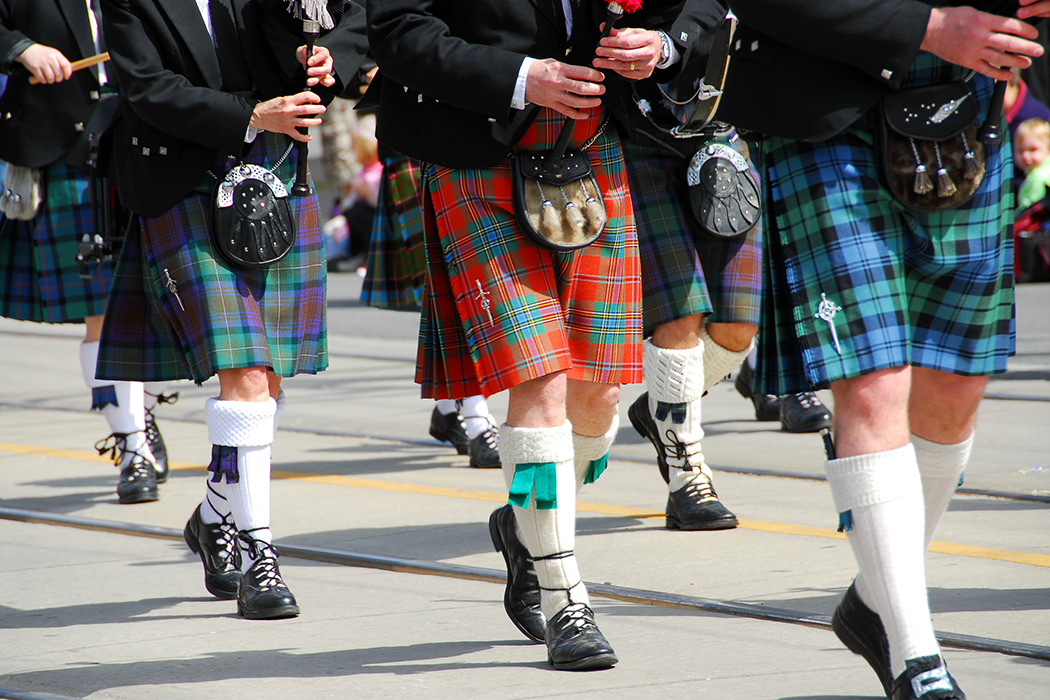 Bagpipers in kilts marching
